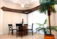 Dining room interior. A simple clean contemporary dining area in a home Stock Images