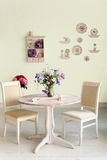 Dining room interior with flowers decorative plates blue wall an Royalty Free Stock Photo