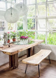 Dining room interior with wooden furniture and plants Stock Photography