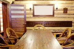 Dining room. Interior of the dining room in the wooden house Royalty Free Stock Photography
