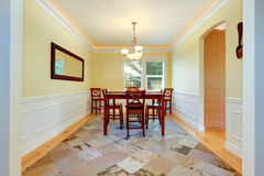 Dining room in ivory color with white trim. Refreshin dining room interior with ivory and white walls and granite tile floor stock photography