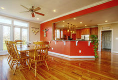 Dining Room and Kitchen Interior. View of a home's dining area with hardwood floors. A kitchen is in the background. Horizontal format Royalty Free Stock Photos