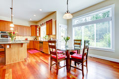 Dining room and kitchen with red cherry wood Stock Images