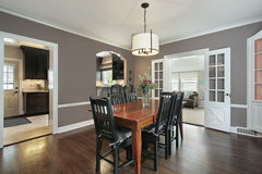 Dining room with kitchen view royalty free stock photography