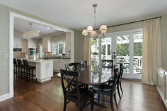 Dining room with kitchen view Stock Image