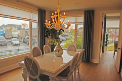 A dining room with large windows. Stock Images