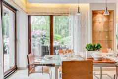 Dining room with large windows Stock Photos