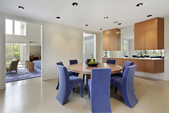 Dining room with lavendar colored chairs Stock Image