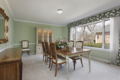 Dining room with lime green walls Stock Photos
