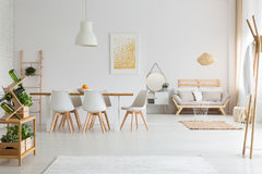 Dining room and living room in loft. Simple dining room and minimalist living room in white lagom loft Stock Photo