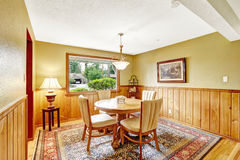 Dining room in log cabin house Royalty Free Stock Photography