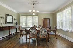 Dining room in luxury home Stock Images