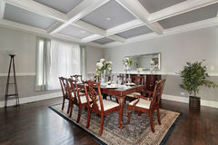 Dining room in luxury home. With white ceiling beams Stock Image