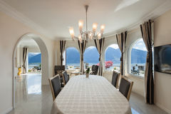 Dining room in luxury house Royalty Free Stock Photos
