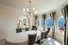 Dining room in luxury house Stock Photos