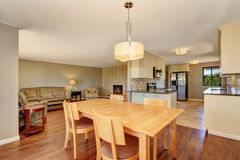 Dining room with maple table and exit to the back deck. Stock Photography