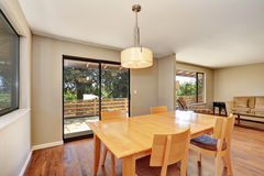 Dining room with maple table and exit to the deck. Royalty Free Stock Images