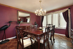 Dining room with maroon walls Stock Photography