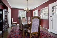 Dining room with maroon walls Stock Image
