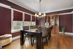Dining room with maroon walls Royalty Free Stock Images