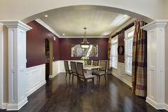 Dining room with maroon walls Royalty Free Stock Photo