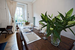 Dining room with massive wood furniture Royalty Free Stock Photography