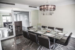 Dining room with modern furniture and chandelier. stock image