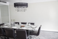 Dining room with modern furniture and chandelier. stock photo