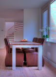 Dining room. Modern dining room with laminate floor and fruits on the table stock photo
