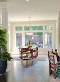 Dining Room in New Luxury Home. An ornate dining room with sunlight streaming through it stock photos