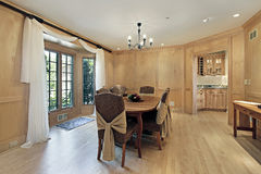 Dining room with oak wood paneling Stock Images