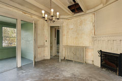 Dining room in old abandoned home Stock Images