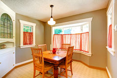 Dining room in old house with carved wood table Stock Photo