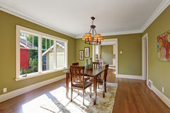 Dining room with olive tone walls Royalty Free Stock Image
