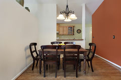 Dining room with orange wall Royalty Free Stock Photo
