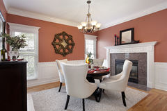 Dining room with orange walls Royalty Free Stock Photos