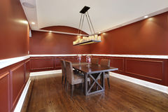 Dining room with orange walls Stock Photography