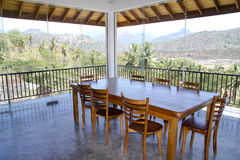 Dining room overlooking nature. A dining room in a tropical area overlooking the natural beauty of the place stock images