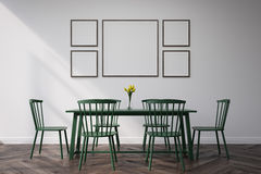 Dining room with pictures. Dining room interior with a long table, four chairs and pictures hanging on a white wall. 3d rendering. Mock up Stock Images