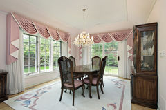 Dining room with pink draperies Royalty Free Stock Photography