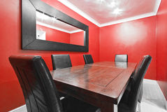 Dining room in red 2. Dining room in red with massive wood table Stock Photo
