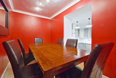 Dining room in red. With massive wood table Stock Image