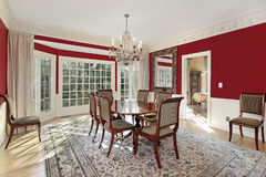 Dining room with red walls Royalty Free Stock Photo