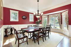 Dining room with red walls Stock Photos