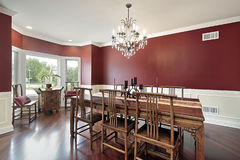 Dining room with red walls Stock Images