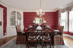 Dining room with red walls Royalty Free Stock Images
