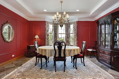 Dining room with red walls Stock Image