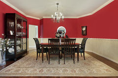 Dining room with red walls Stock Photography