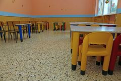 Dining room of a school for young children with small chairs and Royalty Free Stock Photos