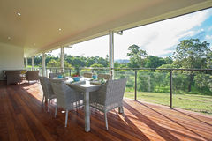 Dining room setting on the patio of modern spacious farm house d Royalty Free Stock Image